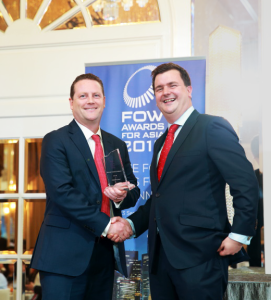TT accepts the award for Trading System of the Year, Buy-Side from FOW's Will Mitting (R) at the FOW Awards for Asia in Singapore.